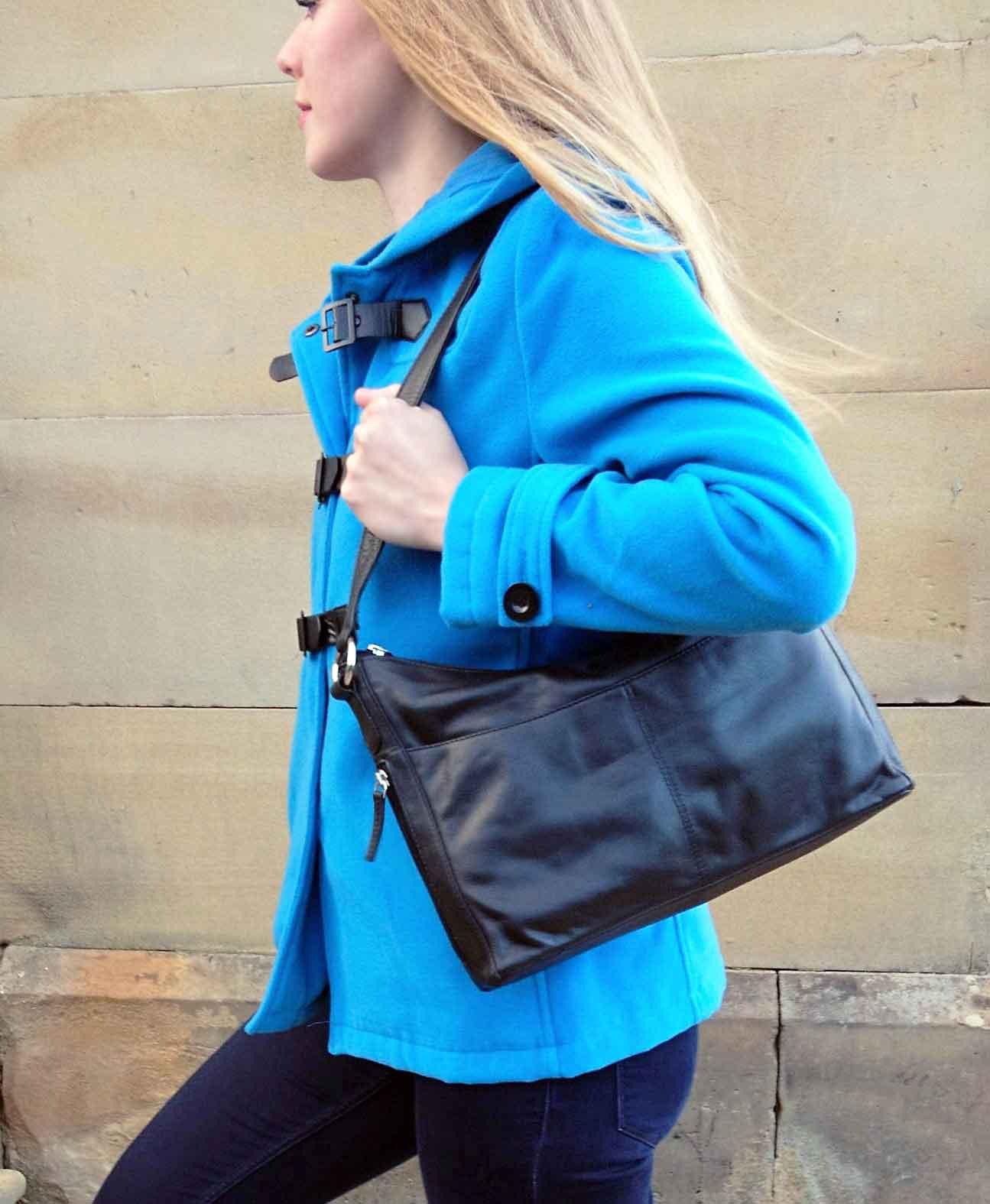 black leather taurus bag